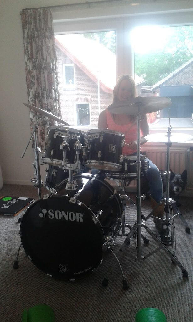 Image of our female student Sharon playing the Sonor Force 3003 drums at home